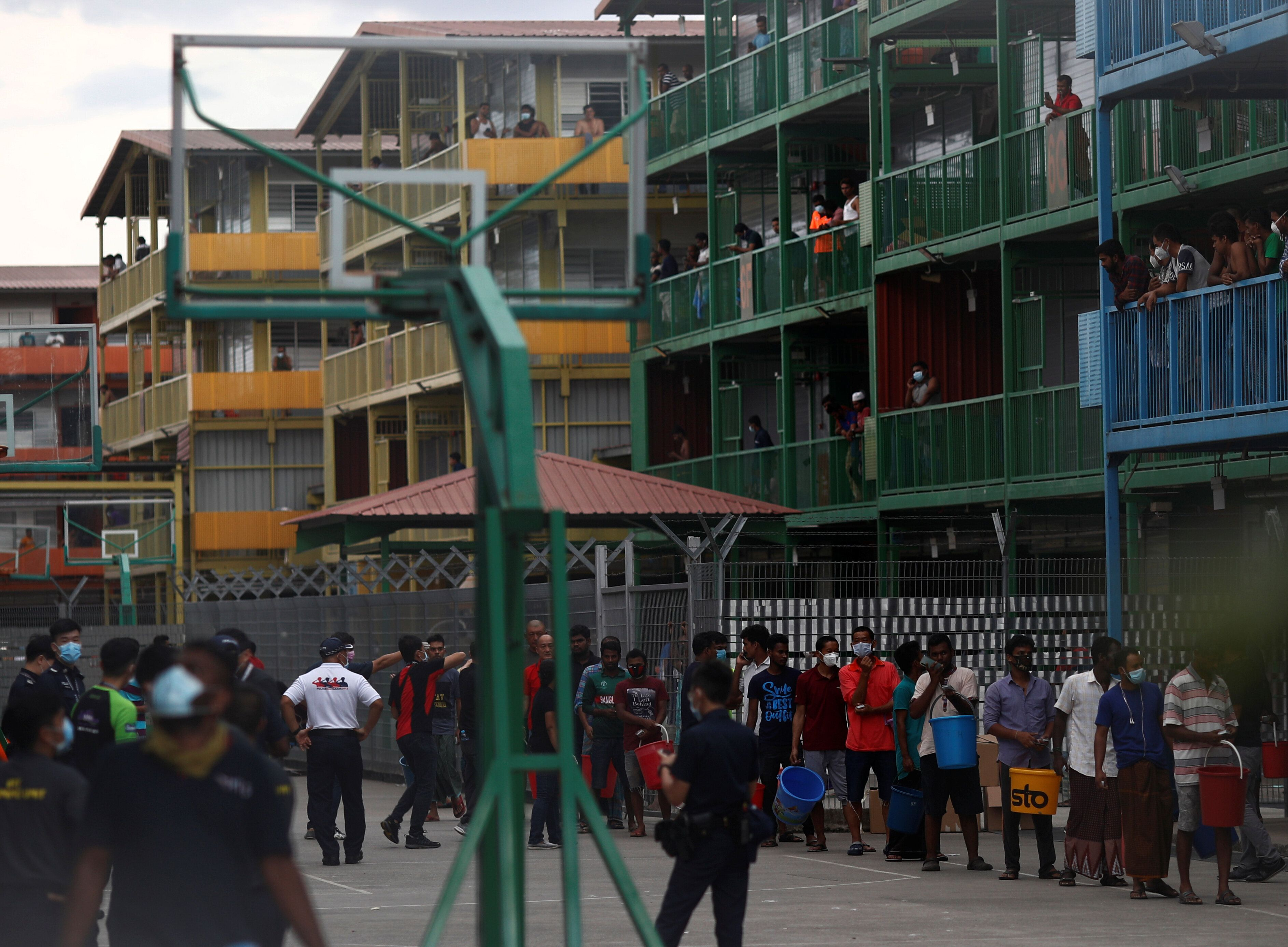 Migrant workers lining up to collect food at the Punggol S11 dormitory in Singapore during the coronavirus outbreak on April