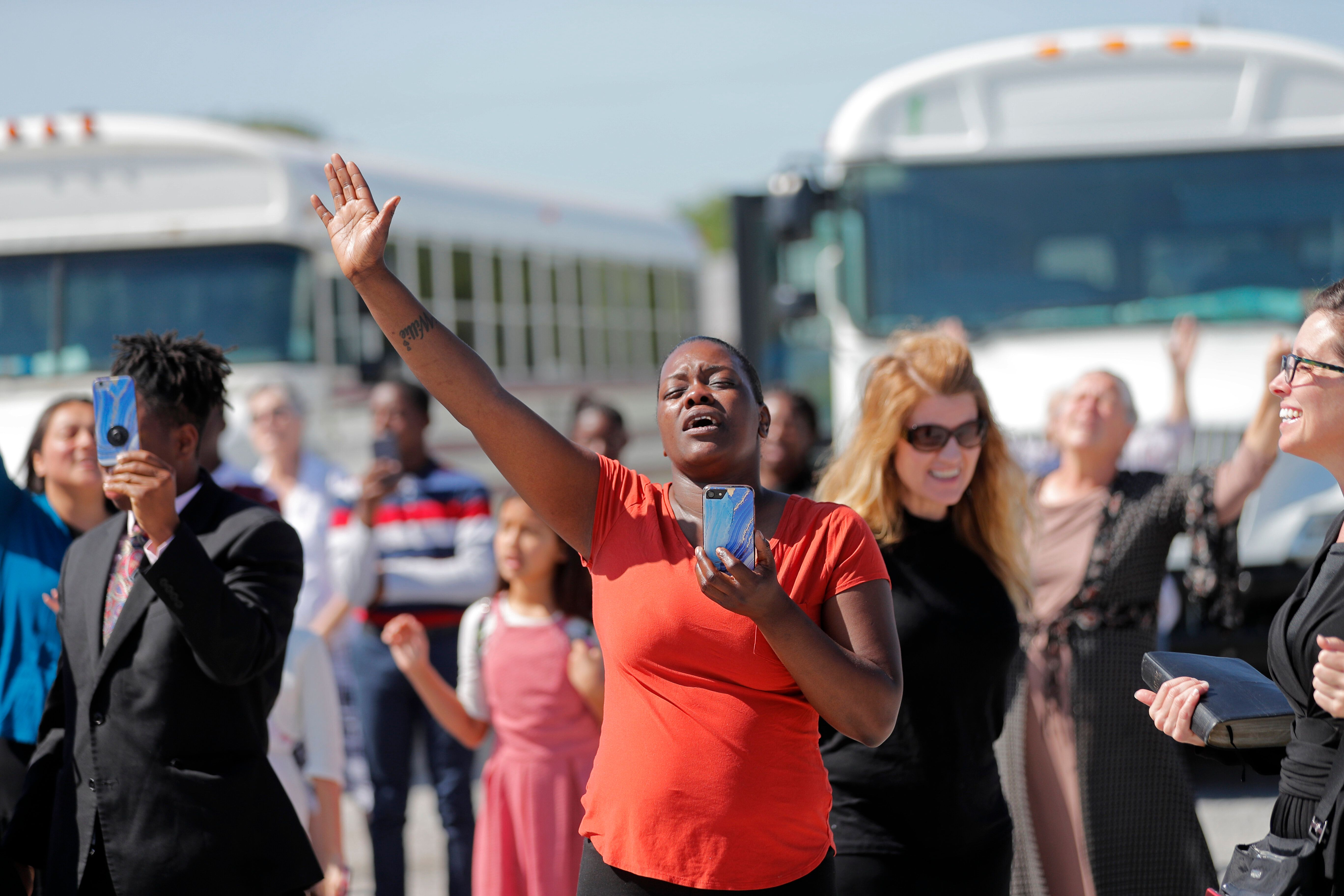 Members of the Life Tabernacle Church, as they wait for Spell to leave the East Baton Rouge Parish jail on April 21, followin