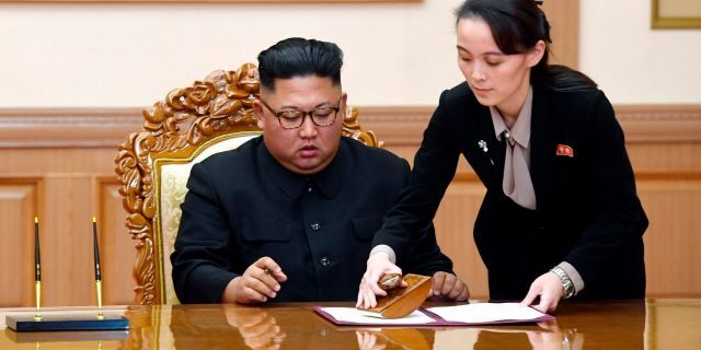In this Sept. 19, 2018, file photo, Kim Yo Jong, right, sister of North Korean leader Kim Jong Un, helps Kim sign joint statement following the summit with South Korean President Moon Jae-in at the Paekhwawon State Guesthouse in Pyongyang.
