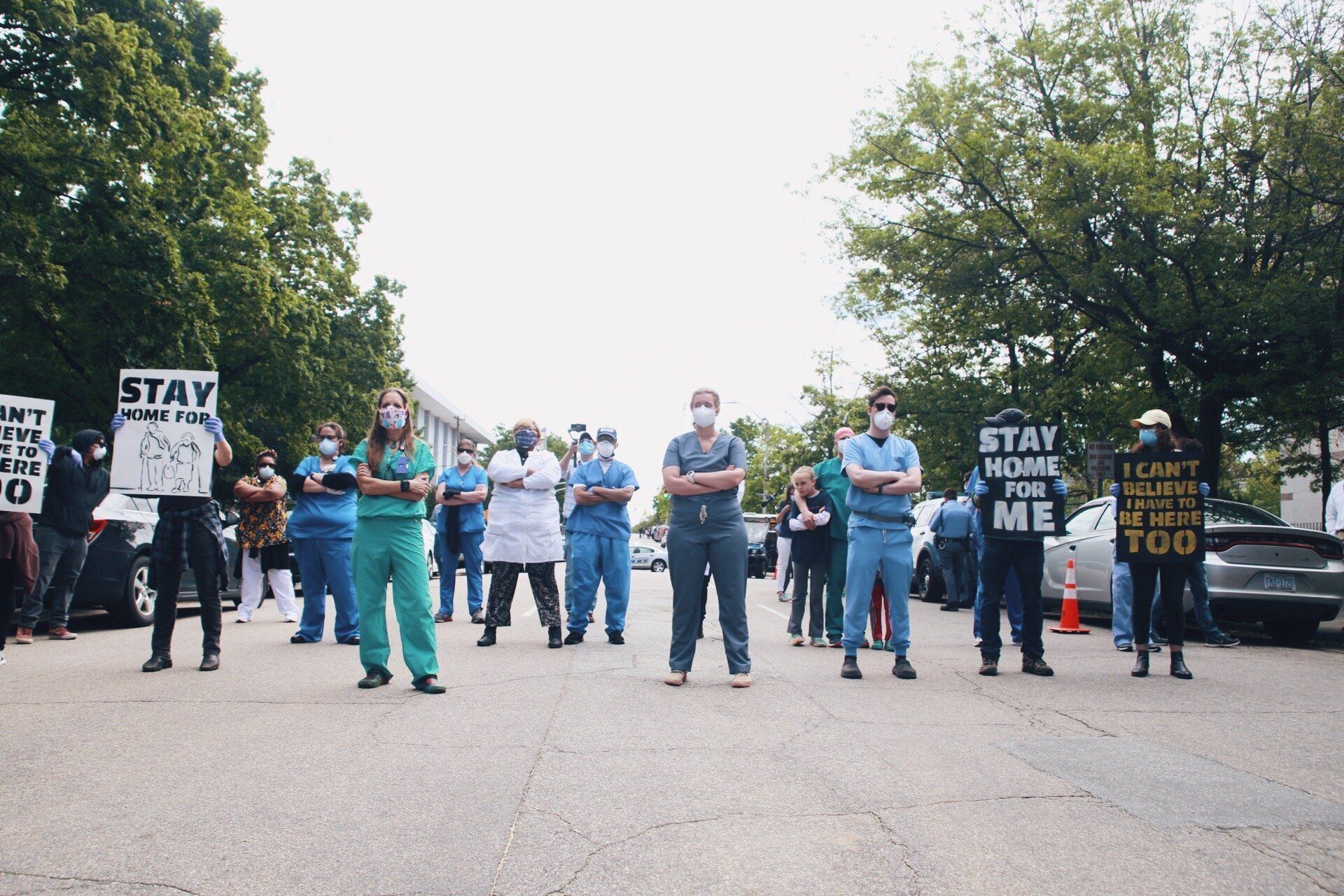 Health care workers holding a counterprotest against anti-lockdown demonstrators in Raleigh, North Carolina, on Tuesday.&nbsp