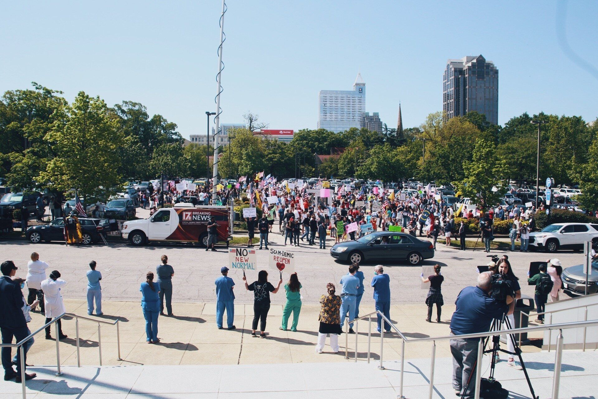 """Health care workers at their counterprotest across from the""""ReOpen NC"""" rally in Raleigh."""