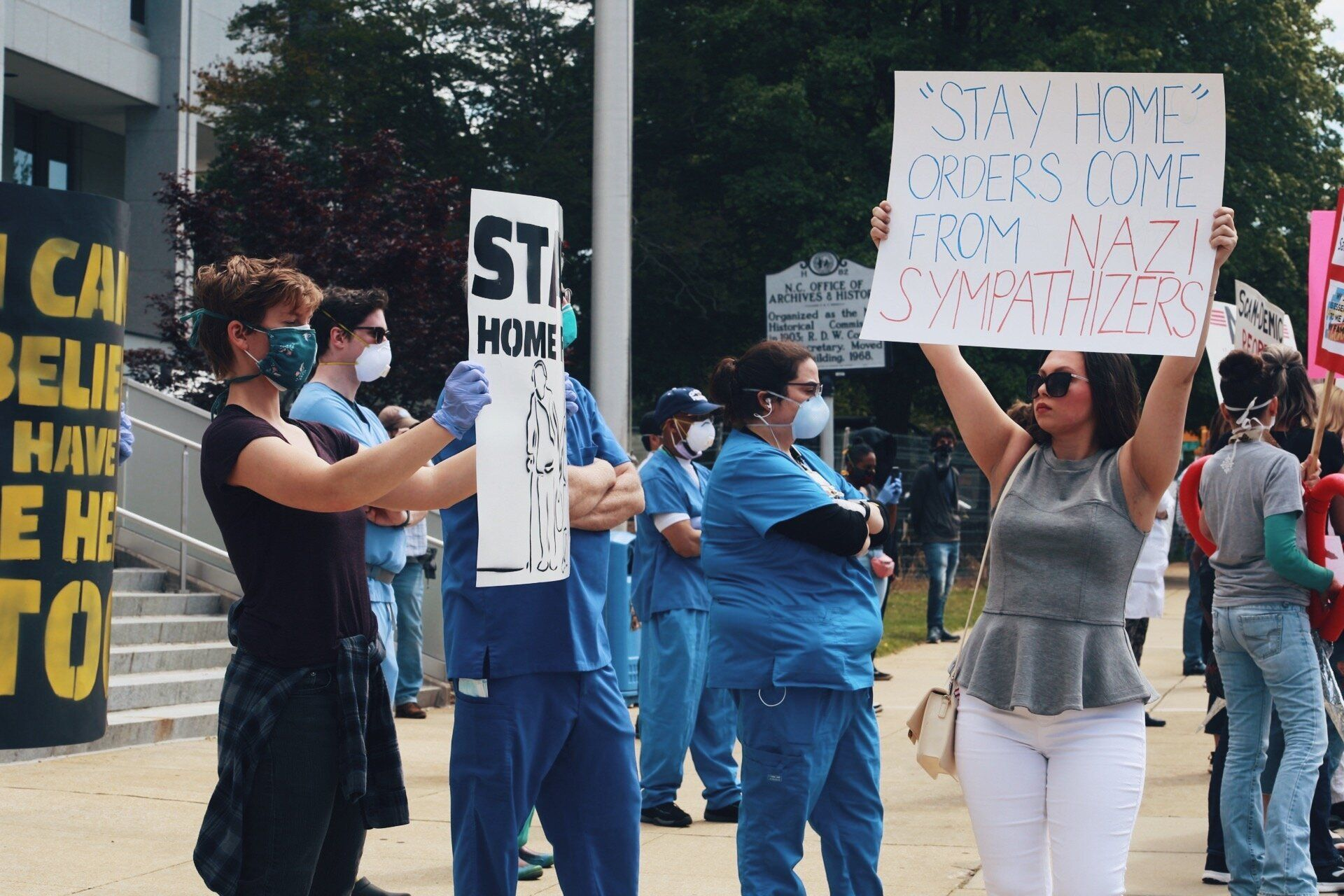 Health care workers staging a counterprotest at the ReOpen NC rally on Tuesday.