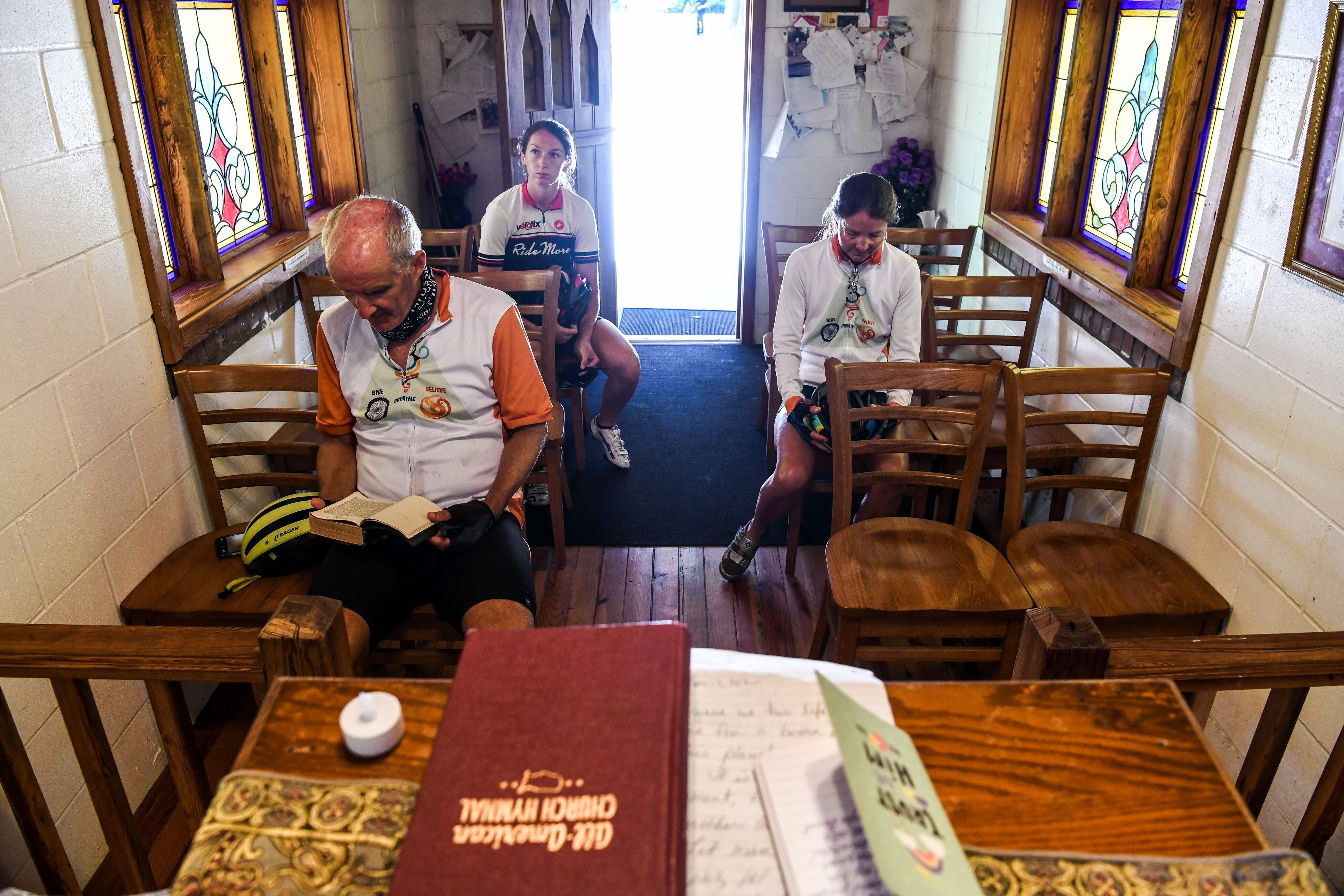 """Worshippers offer prayers inside the """"Smallest Church In America"""" in Townsend, Georgia, during the novel coronavirus pandemic"""