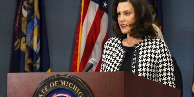In this photo, provided by the Michigan Office of the Governor, Michigan Gov. Gretchen Whitmer addresses the state in Lansing, Mich., Monday, April 20, 2020. (Michigan Office of the Governor via AP, Pool)