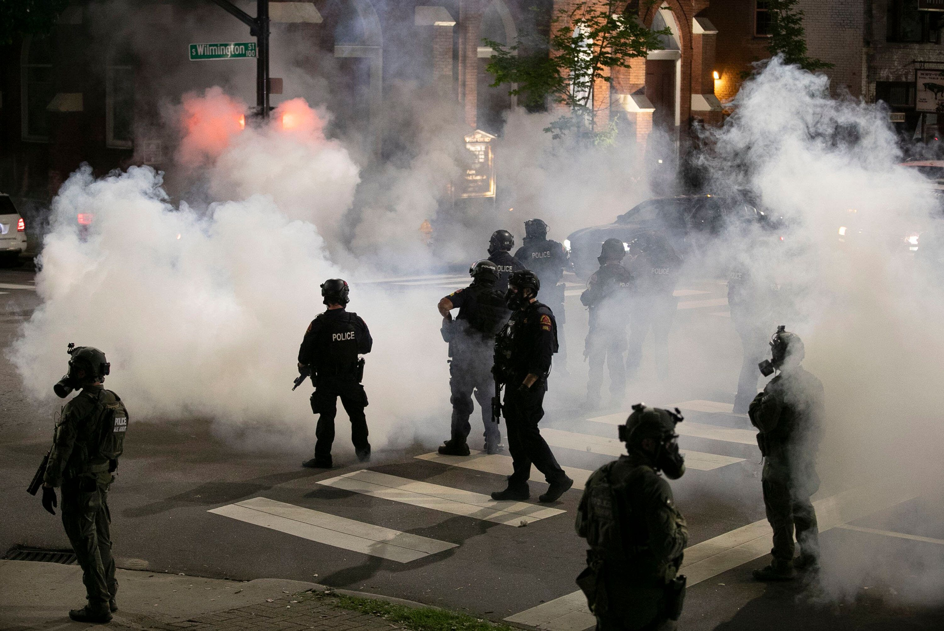Police in Raleigh, North Carolina, fire tear gas to disperse a crowd of demonstrators in front of the First Baptist Church ea