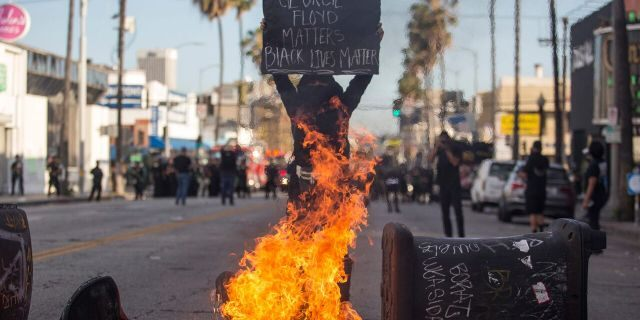 Burning trash cans in Los Angeles on Saturday.