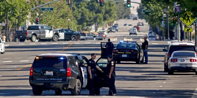 Law enforcement personnel from several jurisdictions patrolling downtown Paso Robles, Calif., on Wednesday.