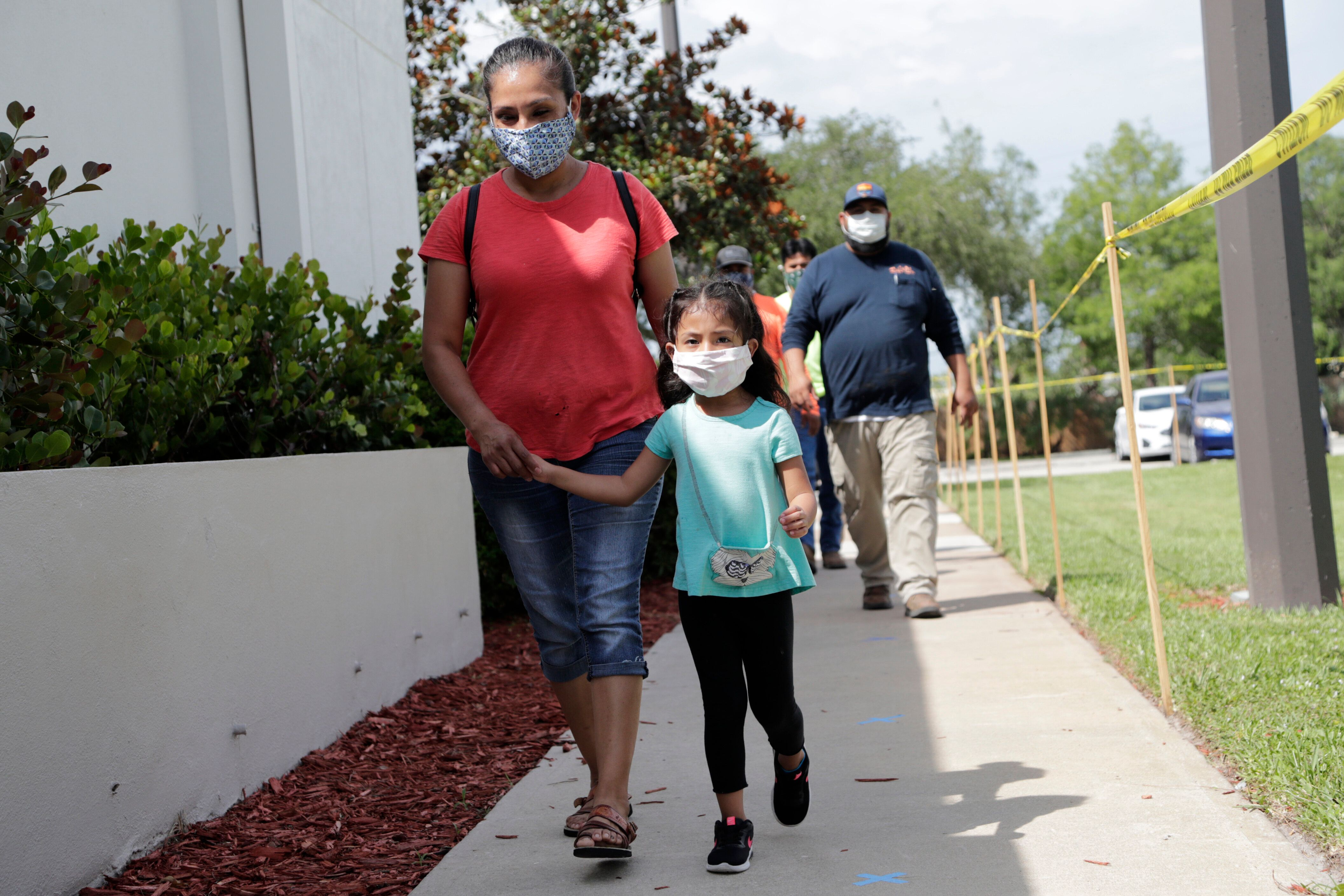 Flora Garcia arrives with her daughter Krislaya Trejo at the Florida Department of Health in Collier County to be tested for