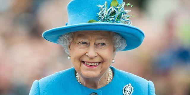 Queen Elizabeth II tours Queen Mother Square on October 27, 2016 in Poundbury, Dorset.