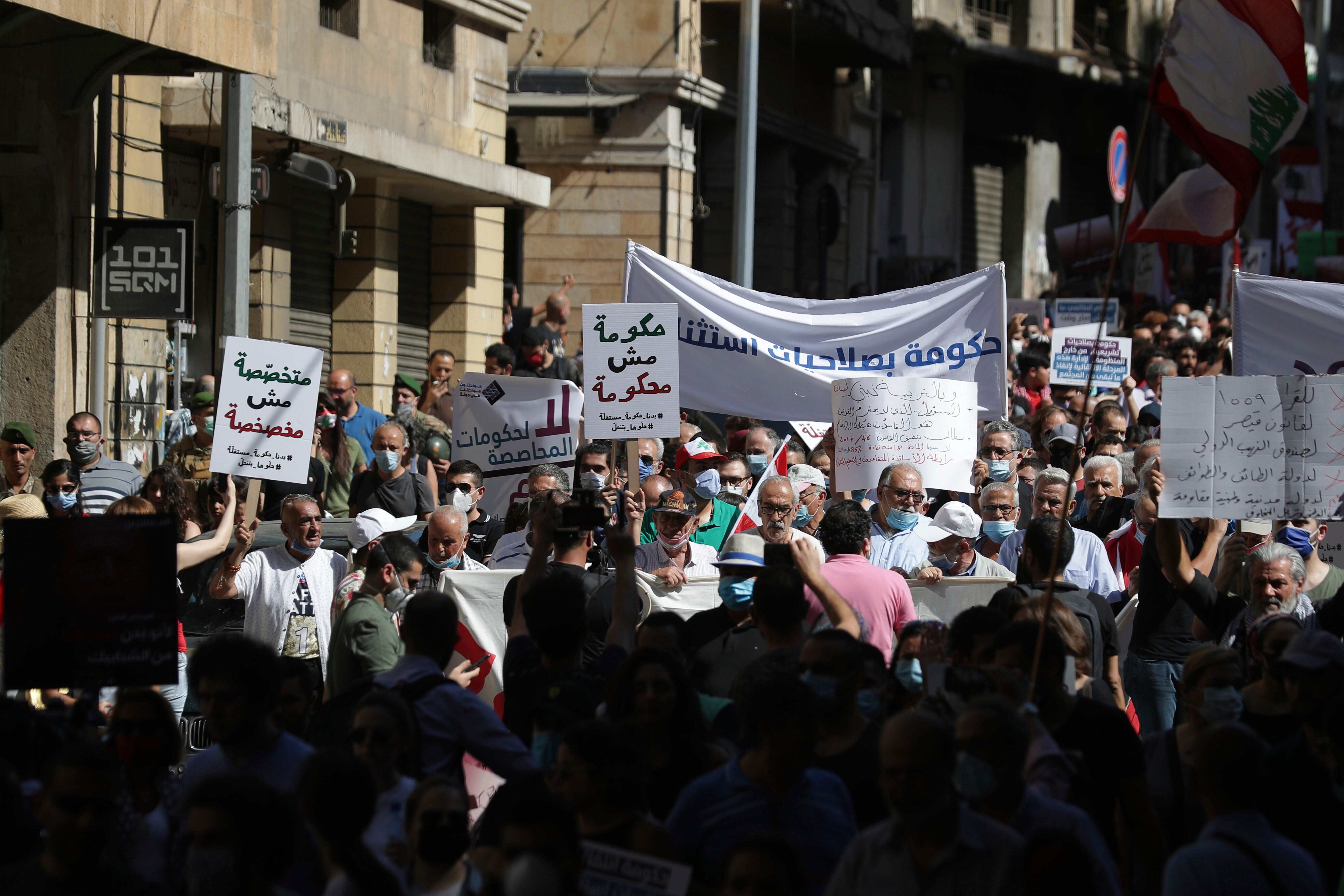 Anti-government protesters shout slogans against the government in Beirut, Lebanon, Saturday, June 13, 2020. (AP Photo/Hassan