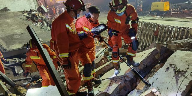 Firefighters look for residents trapped in collapsed buildings in the aftermath of a tanker truck explosion near a highway in Wenling in eastern China's Zhejiang province Saturday, June 13, 2020.