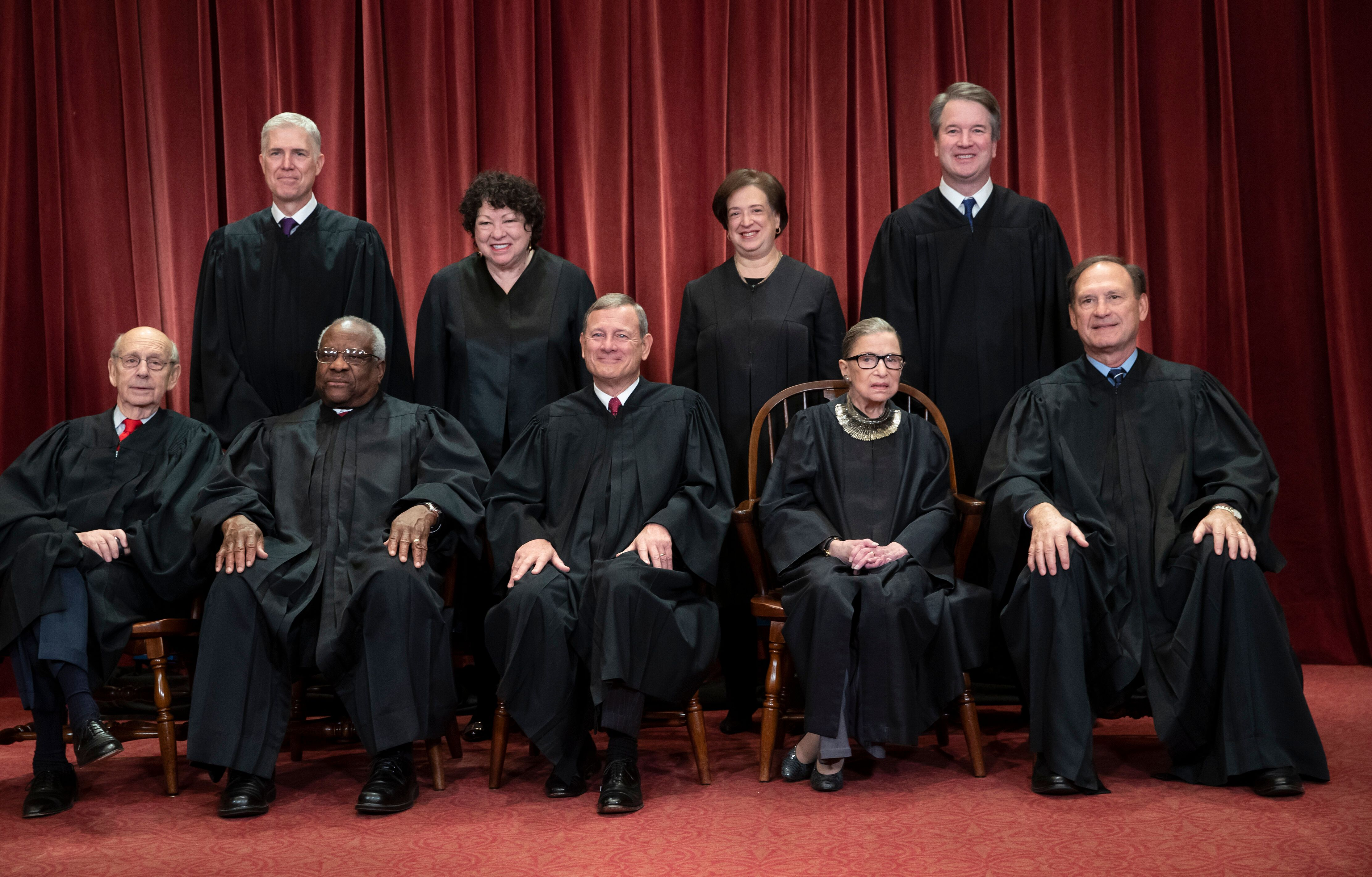 Conservative justices Neil Gorsuch (top row, far left) and Chief Justice John Roberts (bottom row, center) joined the court's