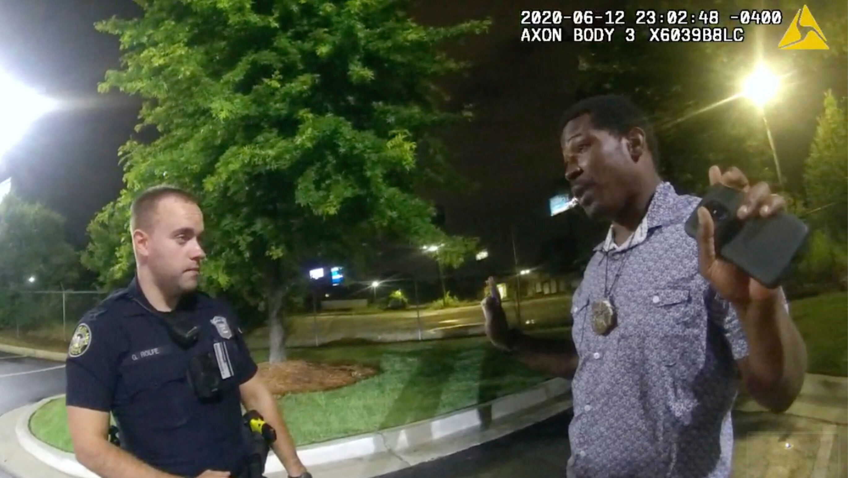 This screen grab taken from body camera video provided by the Atlanta Police Department shows Rayshard Brooks speaking with O
