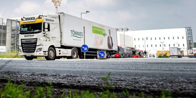 A truck leaves the Toennies meatpacking plant in Rheda-Wiedenbrueck, Germany, where more than 650 new cases of COVID-19 have been recorded among workers at a large meatpacking plant.