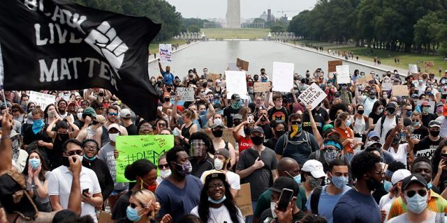 FILE - In this June 6, 2020, file photo, demonstrators protest at the Lincoln Memorial in Washington, over the death of George Floyd, a black man who was in police custody in Minneapolis. Black Lives Matter Global Network Foundation, the group behind the emergence of the Black Lives Matter movement, has established a more than $12 million fund to aid organizations fighting institutional racism in the wake of the George Floyd protests. (AP Photo/Alex Brandon, File)
