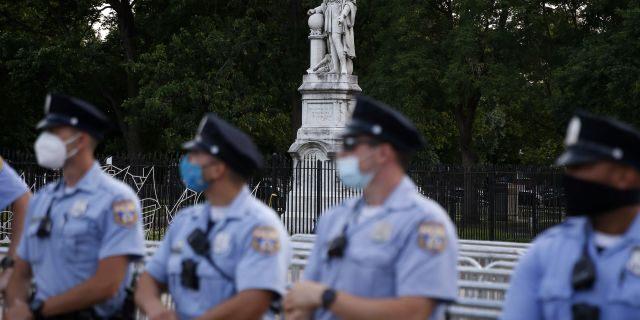 Philadelphia police officers gather near the statue of Christopher Columbus at Marconi Plaza, Monday, June 15, 2020, in the South Philadelphia neighborhood of Philadelphia. (Associated Press)