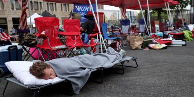 June 19: Supporters of President Trump sleep in the early morning while lined up to attend the Trump campaign rally near the BOK Center, in Tulsa, Oklahoma. (Photo by Win McNamee/Getty Images)