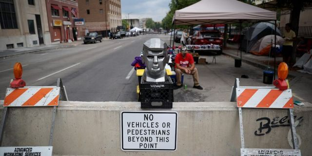 June 19: A metal bust of President Trump is on display outside the BOK Center as people line up to attend his campaign rally in Tulsa, Oklahoma. (Photo by Win McNamee/Getty Images)