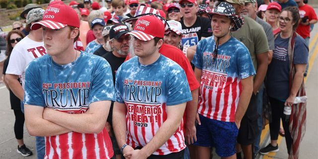 Supporters of U.S. President Donald Trump gather to attend a campaign rally at the BOK Center, June 20, 2020 in Tulsa, Oklahoma. Trump is scheduled to hold his first political rally since the start of the coronavirus pandemic at the BOK Center on Saturday while infection rates in the state of Oklahoma continue to rise.