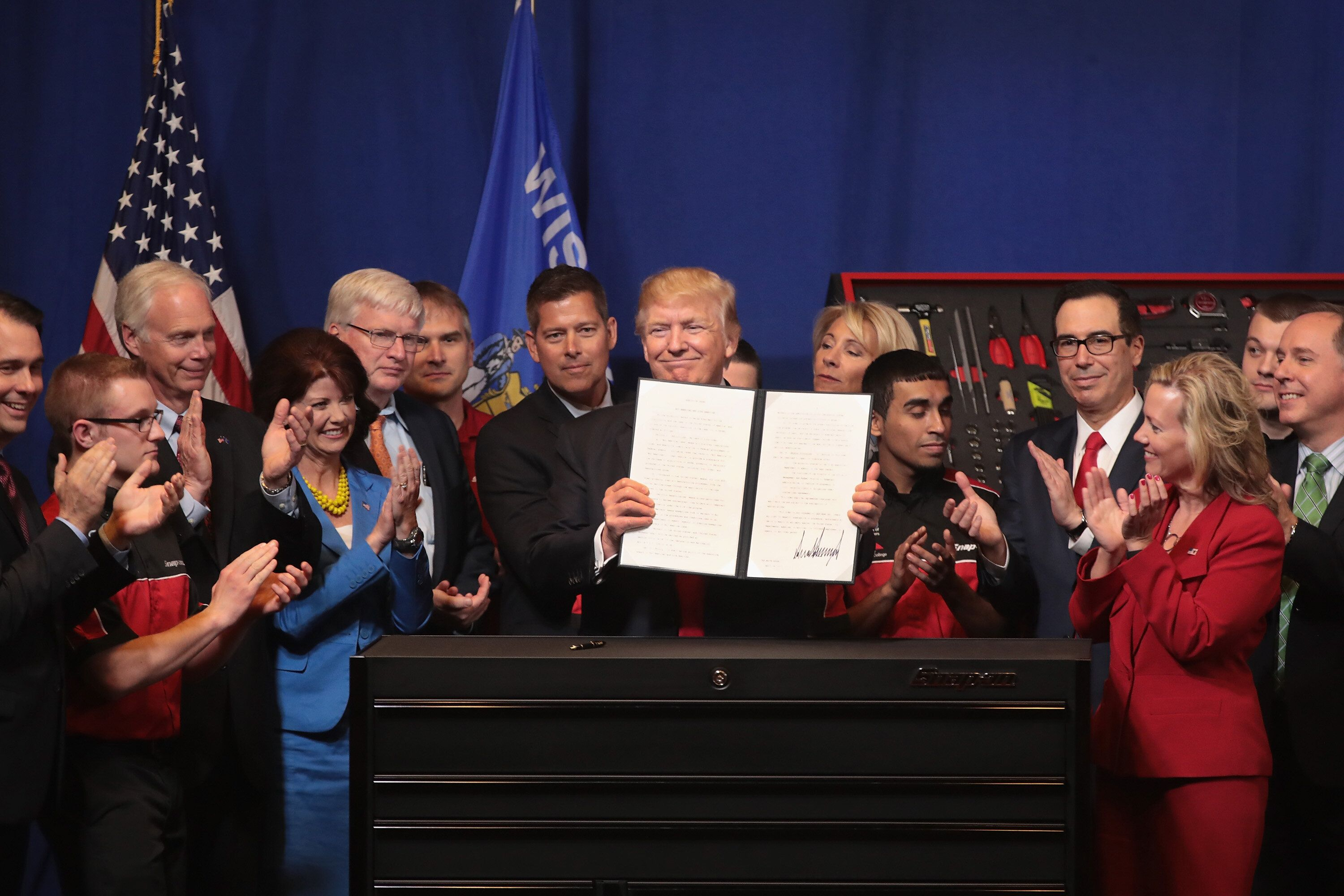 President Donald Trump signs an executive order to revamp the H-1B visa guest worker program and spur U.S. job growth during