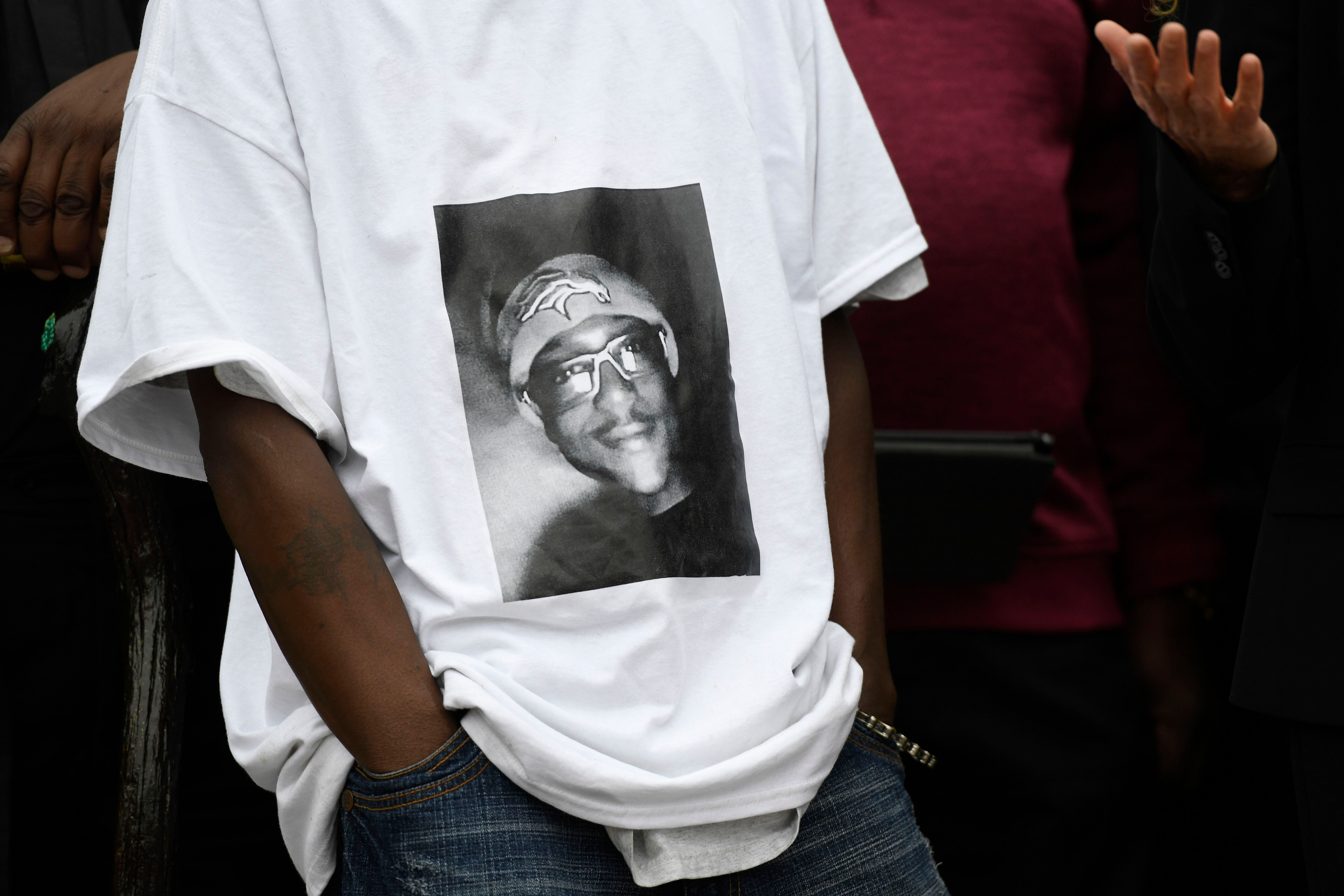 LaWayne Mosley, father of Elijah McClain, wears a T-shirt with is son's picture on it during a press conference in front of t