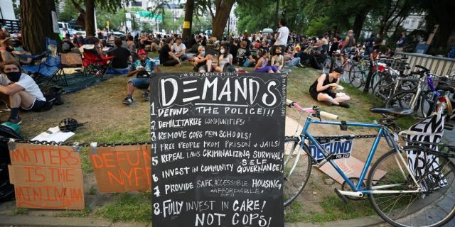 """NEW YORK, USA - JUNE 24: A group of Black Lives Matter protestors congregate at City Hall across from One Police Plaza as part of the """"Defund NYPD"""" and """"Occupy City Hall"""" movement after spending the night on June 24, 2020 in New York City, United States. (Photo by Tayfun Coskun/Anadolu Agency via Getty Images)"""