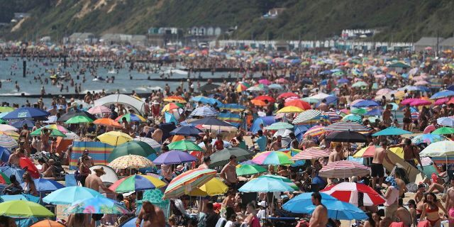 Crowds gather on the beach in Bournemouth as the U.K. experience a heat wave, in Bournemouth, England, on Thursday. (Andrew Matthews/PA via AP)