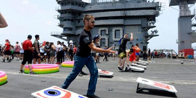 Sailors participate in sporting events on the flight deck of the aircraft carrier USS Dwight D. Eisenhower on June 6, 2020.<br> (Mass Communication Specialist Seaman Brennen Easter/U.S. Navy via AP)