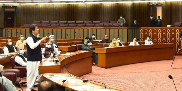 """In this photo released by the Press Information Department, Pakistani Prime Minister addresses the Parliament in Islamabad, Pakistan, Thursday, June 25, 2020. Khan accused the United States on Thursday of having """"martyred"""" al-Qaida leader and the mastermind of the 9/11 attacks, Usama bin Laden. (Press Information Department, via AP)"""