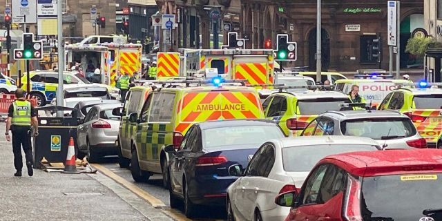 Emergency responders are seen near a scene of reported stabbings, in Glasgow, Scotland, Britain June 26, 2020, in this picture obtained from social media. @JATV_SCOTLAND/via REUTERS