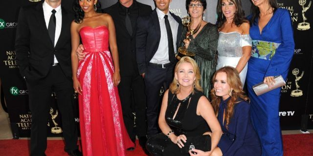 """The cast and crew of """"The Young and the Restless"""" poses in the press room with the award for outstanding drama series at the 41st annual Daytime Emmy Awards in 2014."""