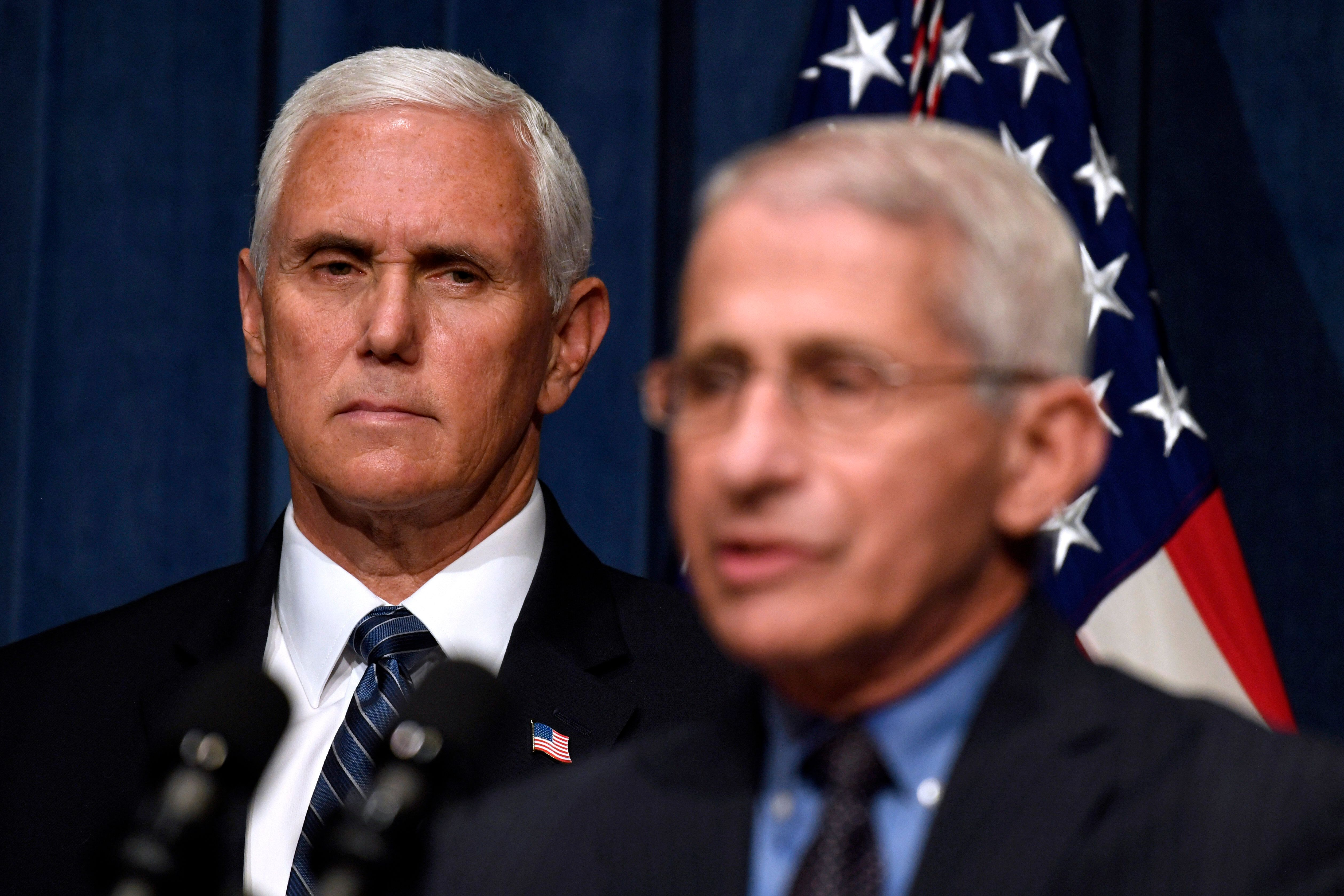Director of the National Institute of Allergy and Infectious Diseases Dr. Anthony Fauci, right, speaks during a news conferen
