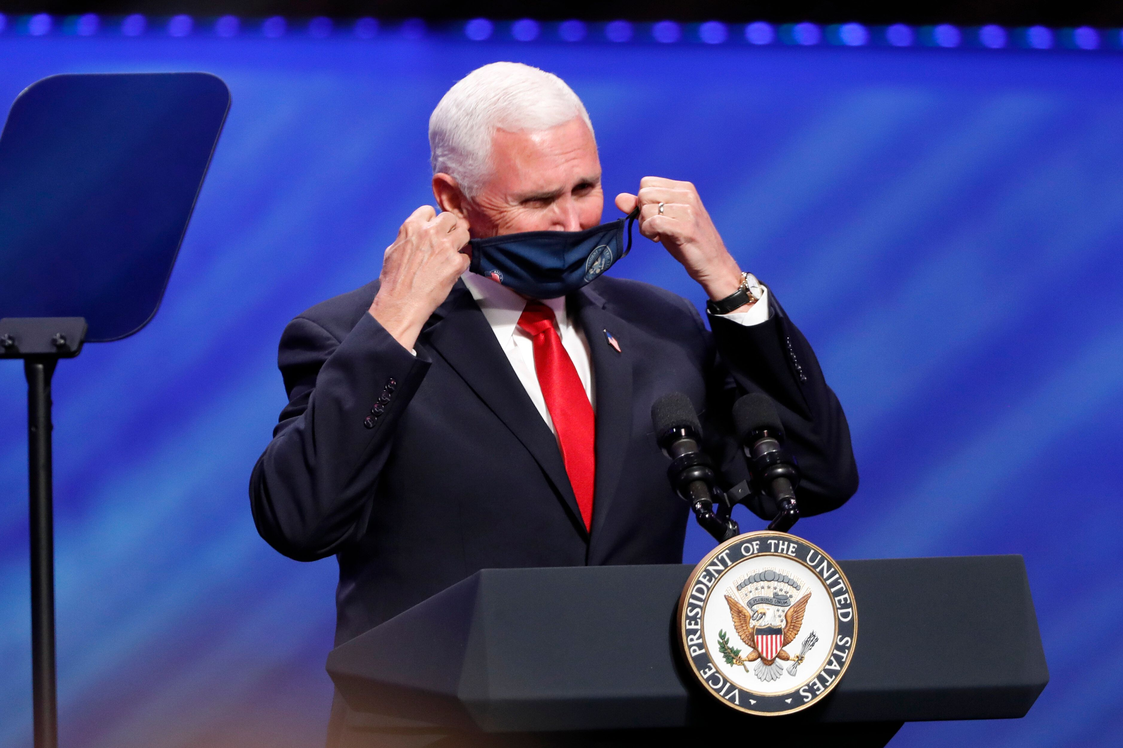 Vice President Mike Pence removes his mask to make comments at First Baptist Church Dallas.