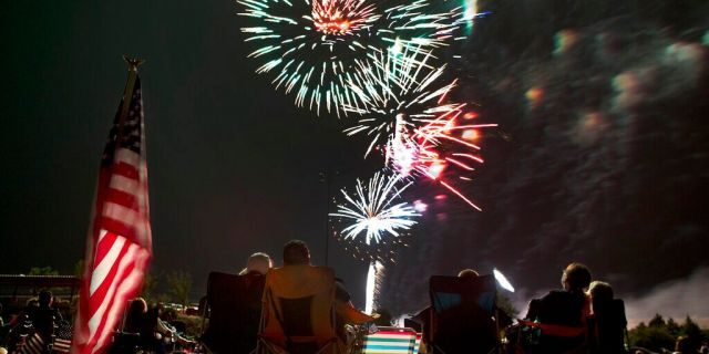 In this July 4, 2013, file photo, people watch as fireworks explode overhead during the Fourth of July celebration at Pioneer Park in Prescott, Ariz. For many Americans, the Fourth of July won't be about big festivities but setting off fireworks themselves. (AP Photo/Julie Jacobson, File)