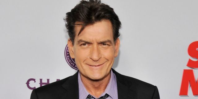 """In this April 11, 2013, file photo, Charlie Sheen, a cast member in """"Scary Movie V,"""" poses at the Los Angeles premiere of the film at the Cinerama Dome in Los Angeles."""
