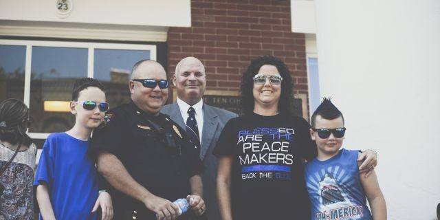 Pastor Perry Cleek pictured with Jonesborough Police Officer, Major Jamie Aistrop and his family during the Independence Day ceremony honoring law enforcement at the Washington County Court House on July 4, 2020.