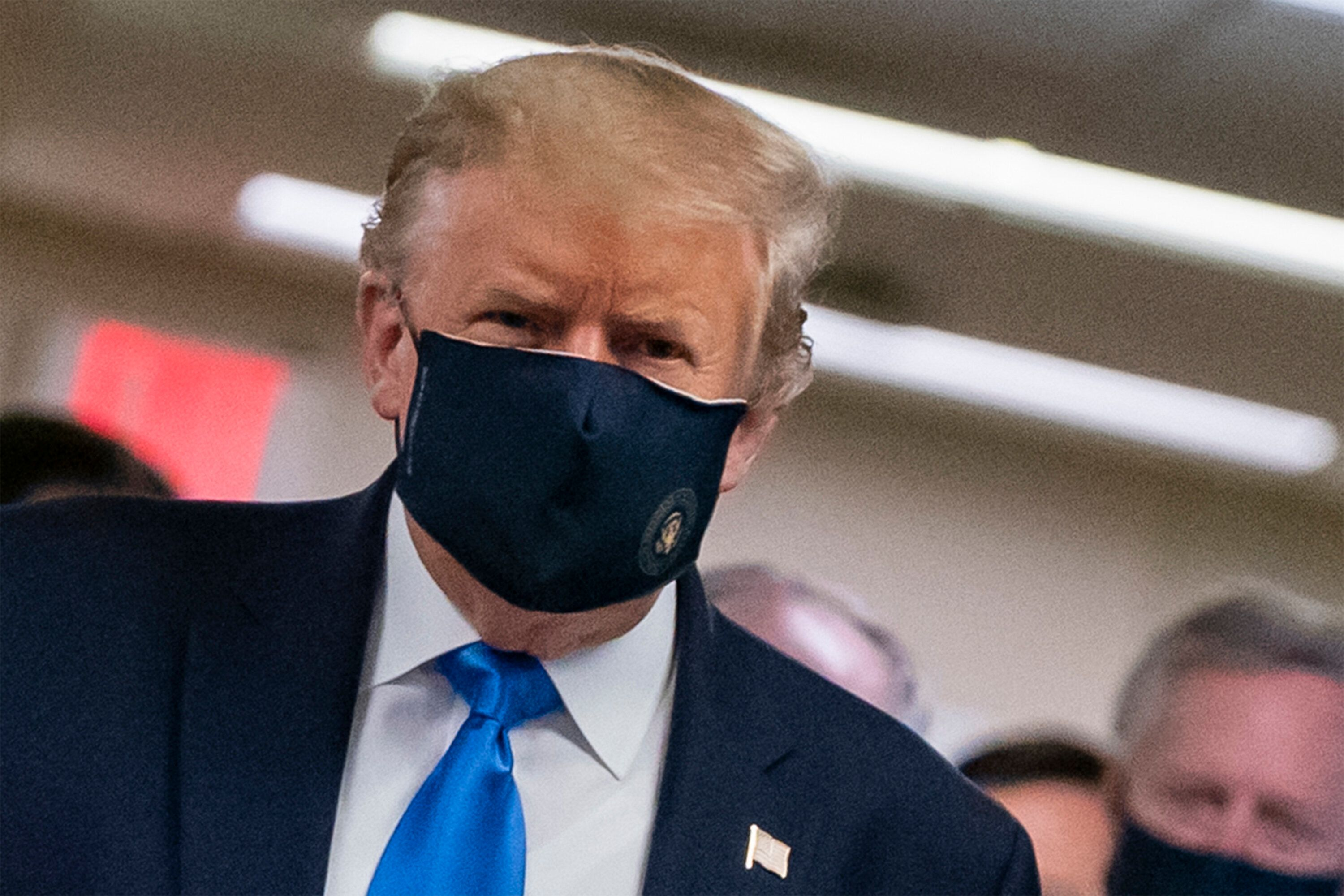 President Donald Trump finally wears a mask as he visits Walter Reed National Military Medical Center in Bethesda, Maryland,