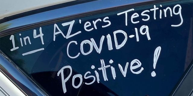 "A slogan is seen on a car in ""a motor march"" protest of teachers who took it to their vehicles to demand a delay in in-person learning in the fall, due to the coronavirus disease (COVID-19) outbreak, in Phoenix, Arizona, U.S., July 15, 2020. Picture taken July 15, 2020. REUTERS/Kelley Fisher NO RESALES. NO ARCHIVES - RC2NVH9P22JL"