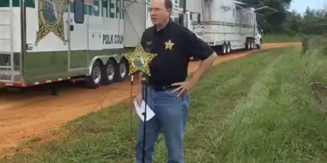 Polk Sheriff Grady Judd briefed reporters Saturday at the scene of a triple homicide on Lake Streety in Frostproof, Florida.
