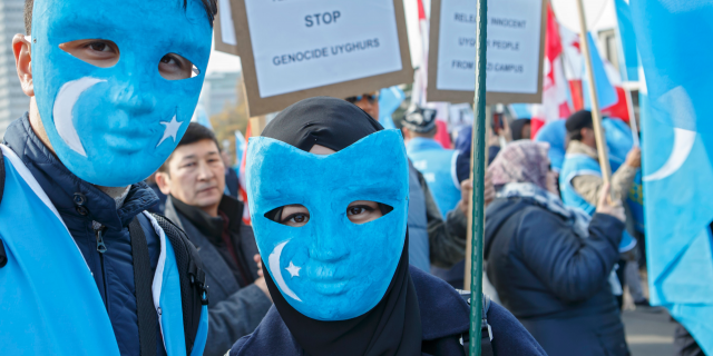 Uyghurs people demonstrate against China during the Universal Periodic Review of China by the Human Rights Council, on the place des Nations in front of the European headquarters of the United Nations, in Geneva, Switzerland, Tuesday, Nov. 6, 2018. (Salvatore Di Nolfi/Keystone via AP)