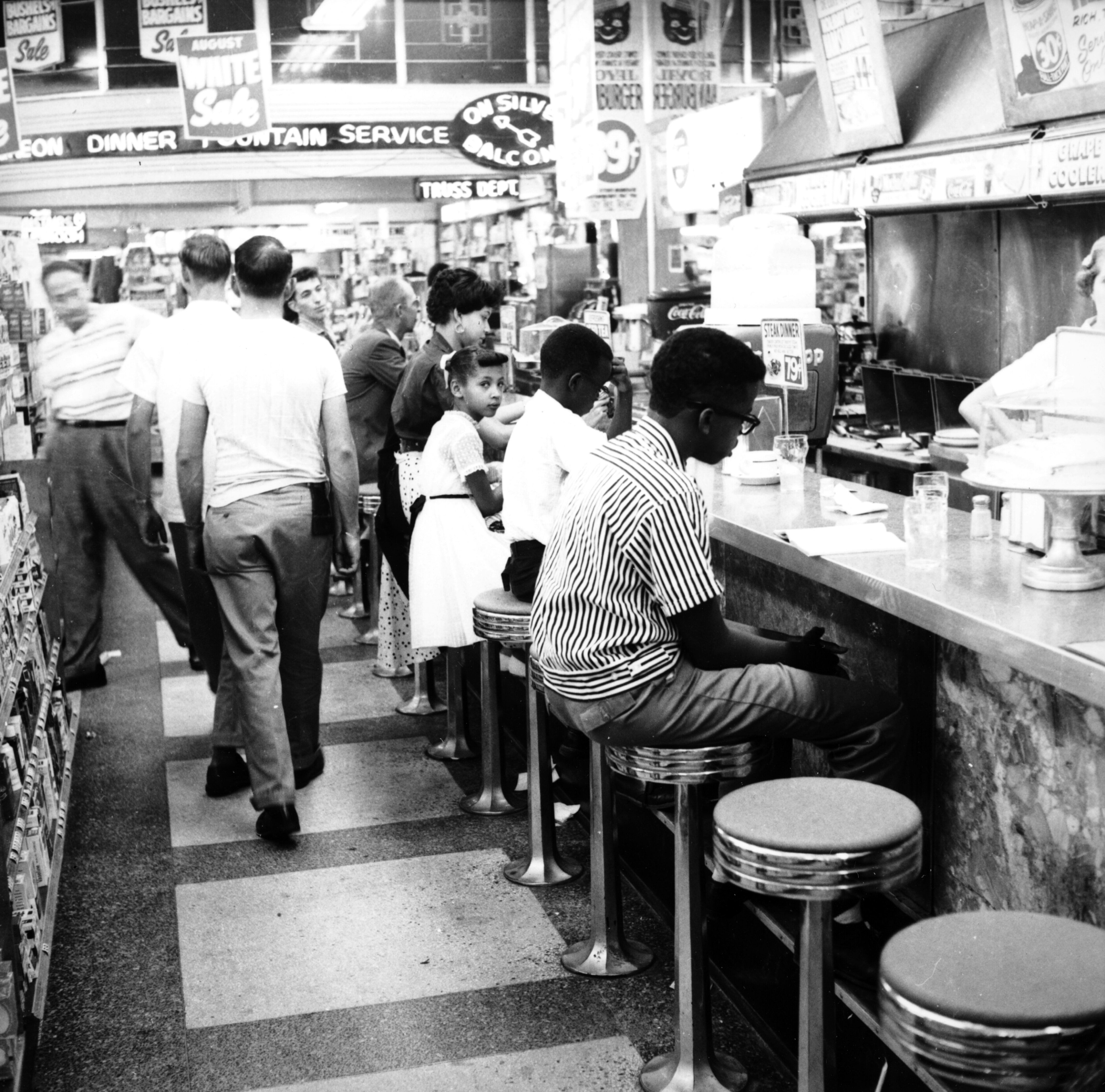 Demonstrators participate in a sit-in to protest the segregation of lunch counters across the nation.