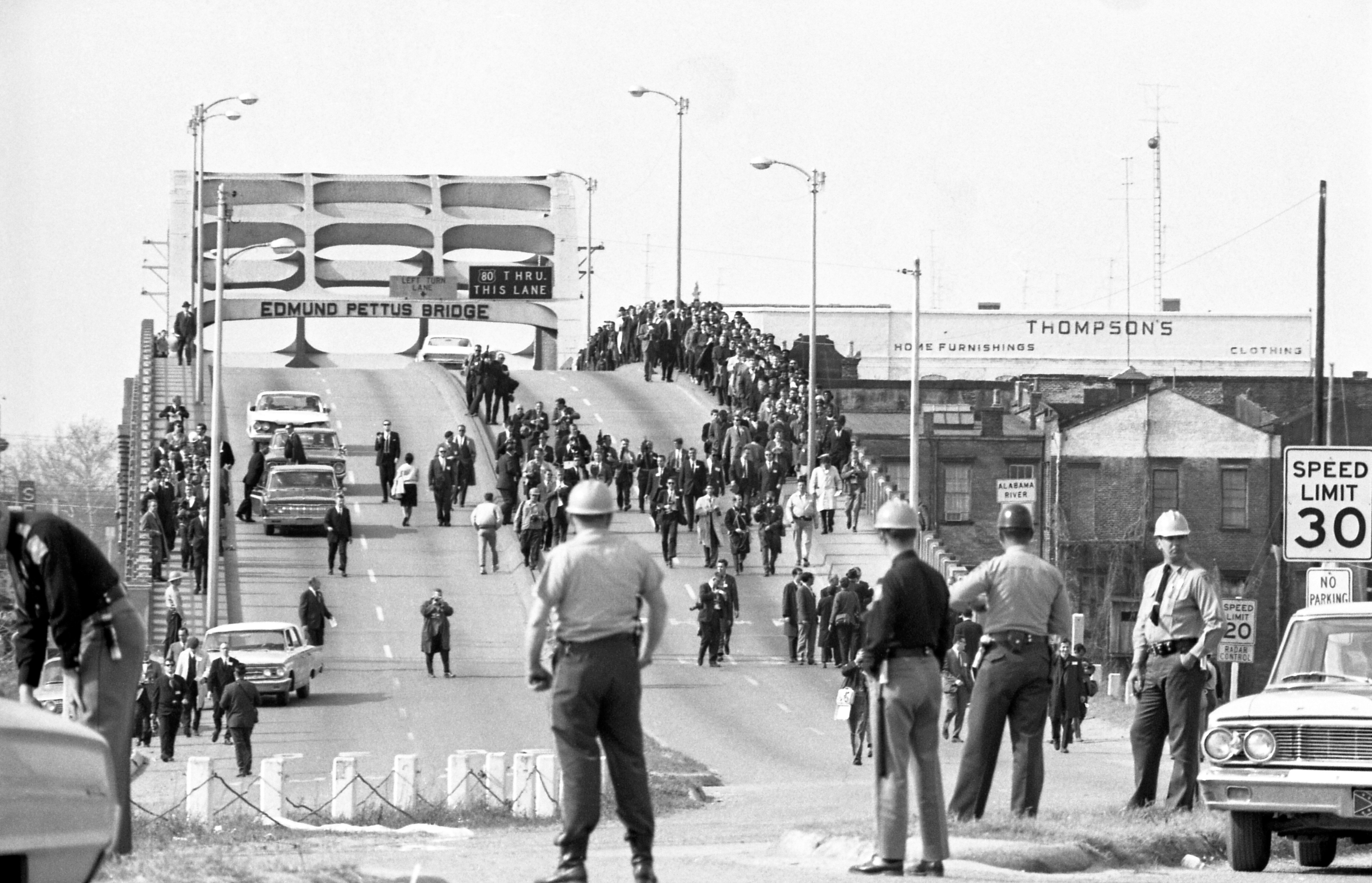 Demonstrators march across the Edmund Pettus Bridge in Selma, Alabama, on March 9, 1965, just two days after the violent back