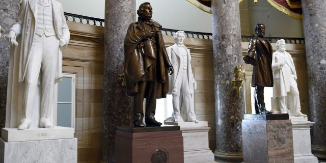 FILE - In this June 24, 2015 file photo, a statue of Jefferson Davis, second from left, president of the Confederate States from 1861 to 1865, is on display in Statuary Hall on Capitol Hill in Washington. The House voted July 22, 2020, to remove statues of Confederate figures such as Jefferson Davis from the U.S. Capitol. (AP Photo/Susan Walsh, File)