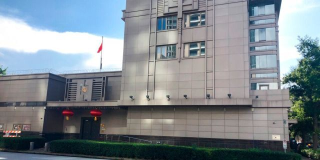The Chinese Consulate General in Houston. Police and fire officials there responded to reports that documents were being burned in the courtyard of the consulate Tuesday night, according to the Houston Police Department. (AP Photo/John Mone)