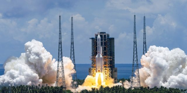 A Long March-5 rocket carrying the Tianwen-1 Mars probe lifts off from the Wenchang Space Launch Center in southern China's Hainan Province, Thursday, July 23, 2020. China launched its most ambitious Mars mission yet on Thursday in a bold attempt to join the United States in successfully landing a spacecraft on the red planet. (Cai Yang/Xinhua via AP)