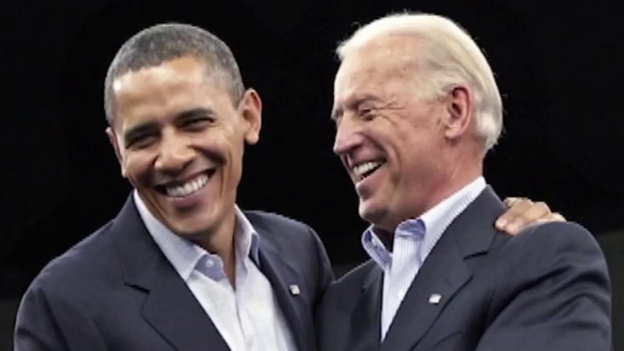 Biden, Obama take shots at Trump in new campaign video