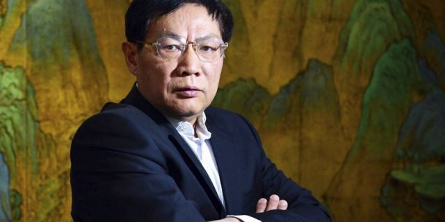 In this Dec. 3, 2012, file photo, Chinese real estate mogul Ren Zhiqiang poses for photos in his office in Beijing. Ren, former chairman of a state-owned real estate company who publicly criticized Chinese President Xi Jinping's handling of the coronavirus pandemic has been expelled from the ruling Communist Party and will be prosecuted on corruption charges, the party announced Friday, July 24, 2020.