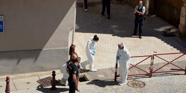 French police stand next to a storm drain where the body of Laure Bardina-Kruger was found, in Peyriac de Mer, southern France, Friday, July 24, 2020. (AP Photo/Christophe Barreau)