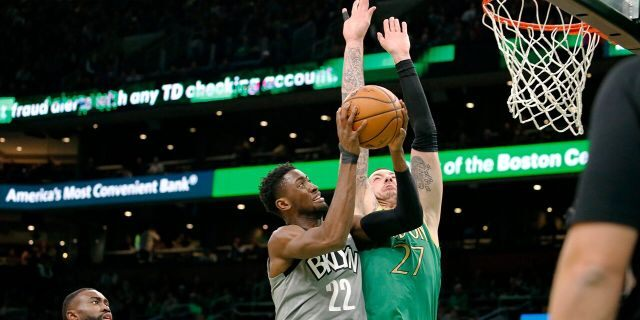 Brooklyn Nets guard Caris LeVert (22) drives to the basket against Boston Celtics' Daniel Theis during the first half of an NBA basketball game Tuesday, March 3, 2020, in Boston. (AP Photo/Mary Schwalm)
