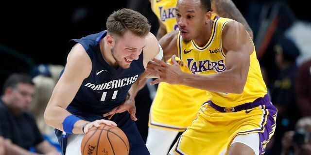 Dallas Mavericks' Luka Doncic, left, works against Los Angeles Lakers' Avery Bradley during the first half of an NBA basketball game in Dallas, Friday, Nov. 1, 2019. (AP Photo/Tony Gutierrez)